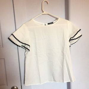 White Top with Ruffle Sleeves and Black Scallops